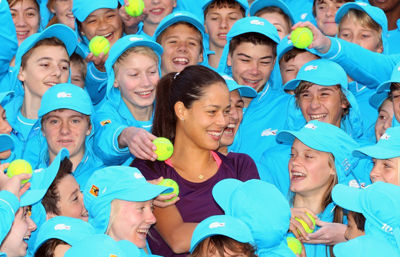 Ana Ivanovic with ballkids AO 2012
